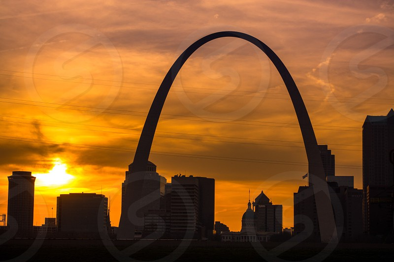 Sun setting behind the Arch in St Louis.  photo