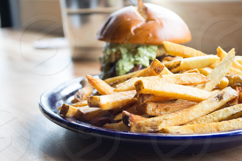 potato fries and hamburger on blue ceramic plate photo