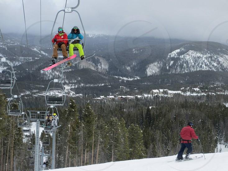 Ski lift snowboard skiing mountains overlook forest cloudy foggy mountain snow photo