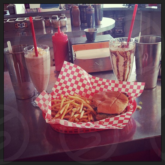 French fries and burger in red plastic tray photo