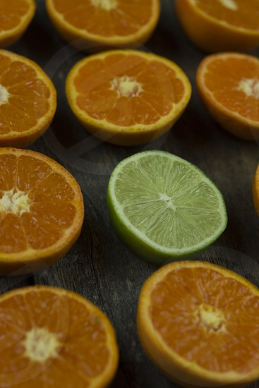 The lime is trying to stand out in the crowd of oranges photo