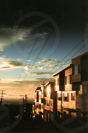 Apartment buildings at sunset with power lines photo
