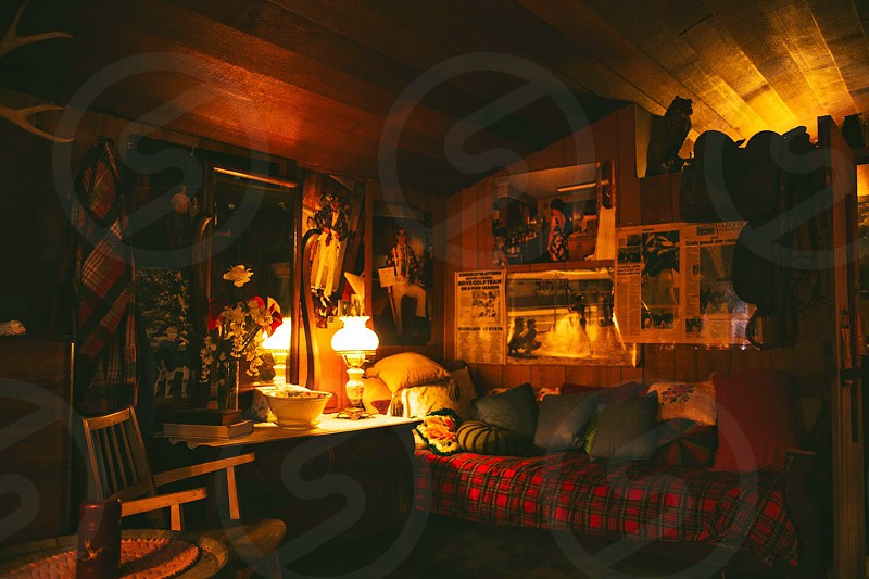 Bunk house cabin camping lamp oil lamp warn old vintage country retro history wood basin bed pillows bunk photo