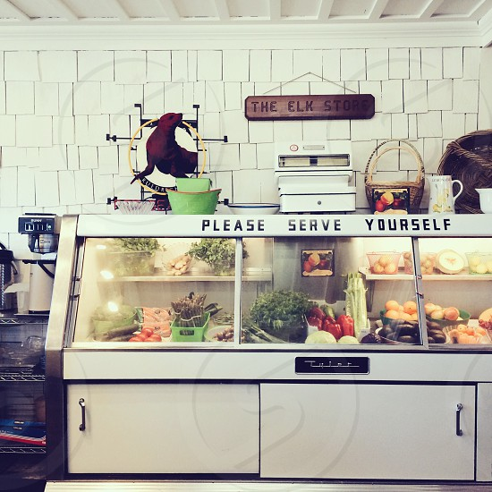 please serve yourself the elk store white counter photo