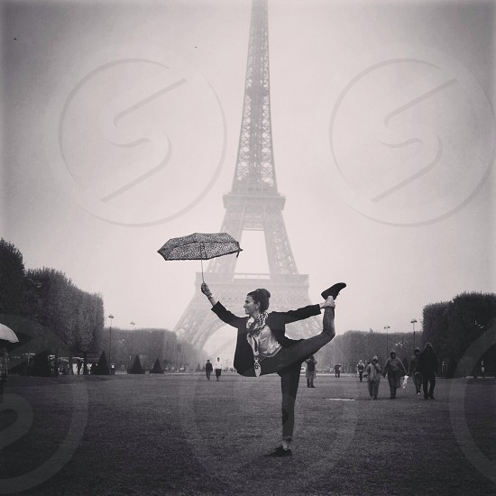 Yoga in the rain at the Eiffel Tower in Paris  photo