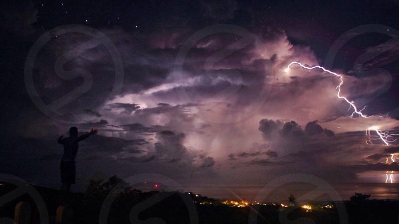 view lightning strikes on purple clouds  photo