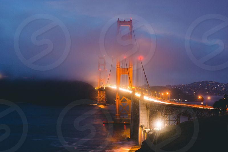 San Francisco California fog bridge evening clouds Golden Gate Bridge light trail photo