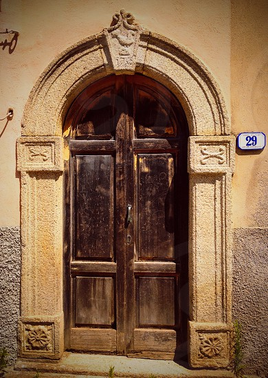 Old door with granite frame in Italy photo