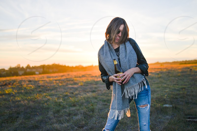 woman wearing a grey scarf and blue denim jeans photo