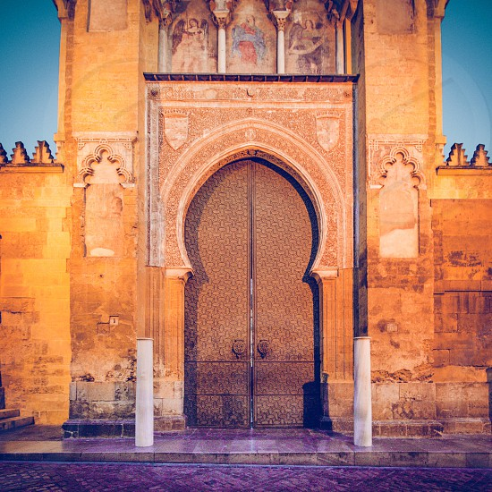 Islamic Andalusian door by night photo