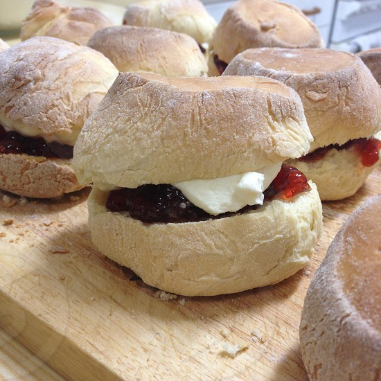 Scones with jam and whipped cream photo