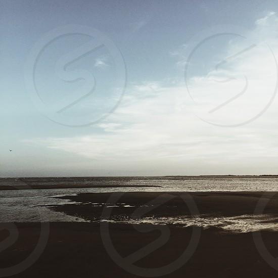 a photo of seashore and blue sky photo