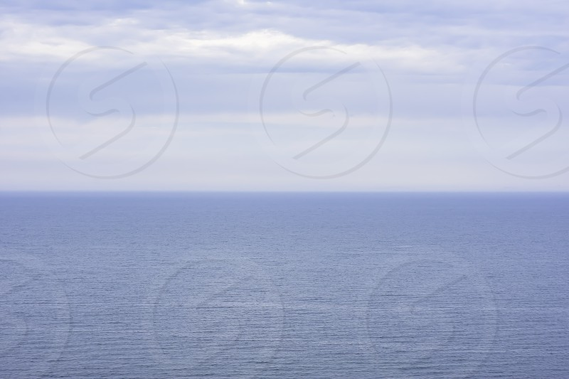 Blue sea and sky with blurred horizon line.Moody and atmospheric image.Nature uk.Idyllic and minimalistic seascape.Emptiness.Big blue.Great natural background with lots of space for edit or text. photo