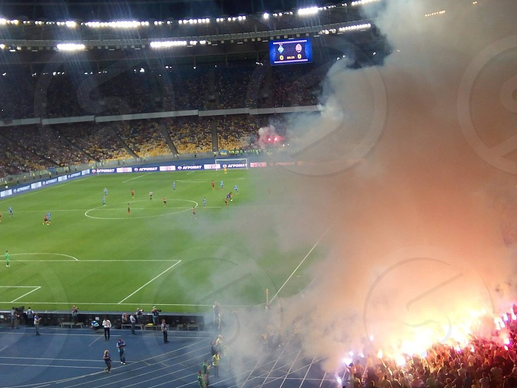 bird's eye view of a soccer field with white smoke during daytime photo