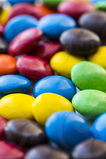 Colorful candies yellow orange green blue red brown photo
