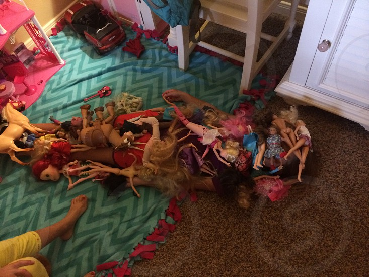 Little girl?  Or pile of Barbie dolls? photo