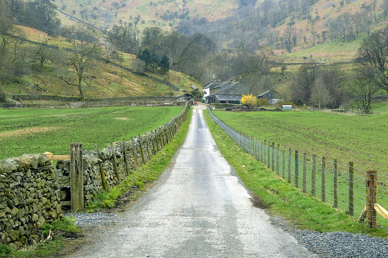 Road leading up to an isolated country farm in the hills of England's Lake District. photo