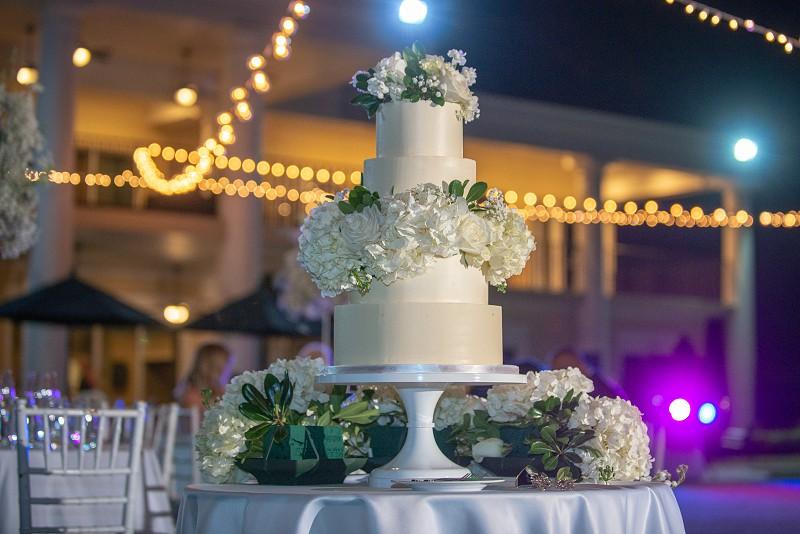 White wedding cake outdoor wedding photo