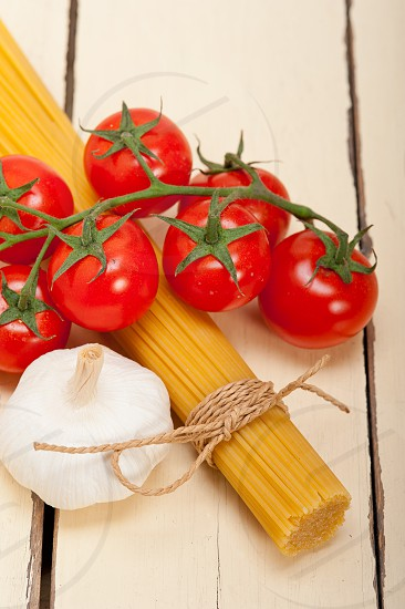 Italian basic pasta fresh ingredients cherry tomatoes garlic photo