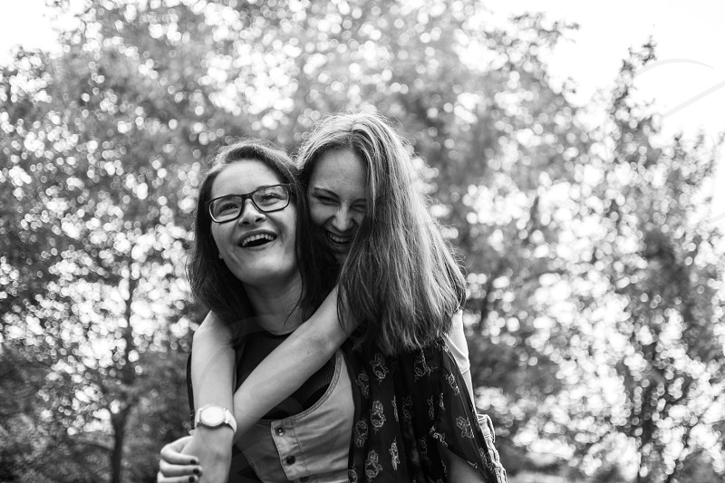 Two female friends hugging. photo