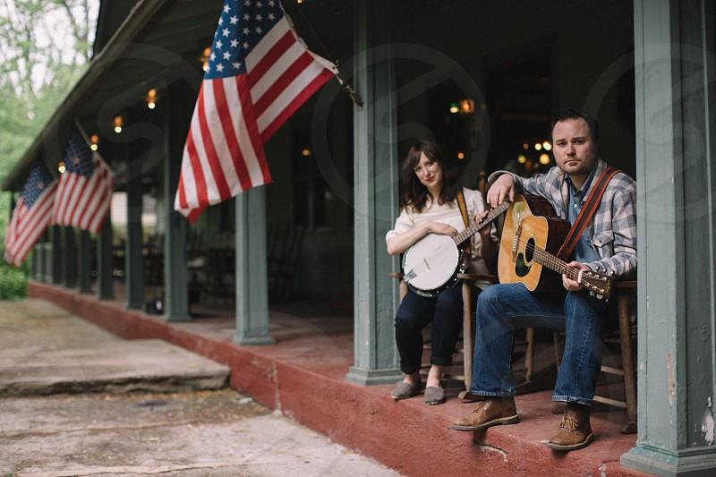 americana folk banjo guitar music porch couple love musician flag patriotic lifestyle photo