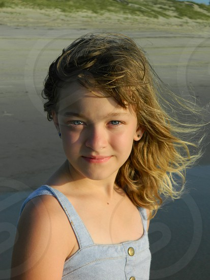 9 year old daughter on the beach photo
