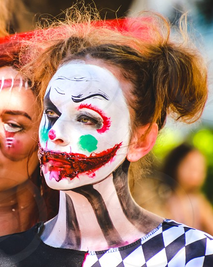young women in costume at a street parade face paint Halloween 👻 fun scary monster walking dead  photo