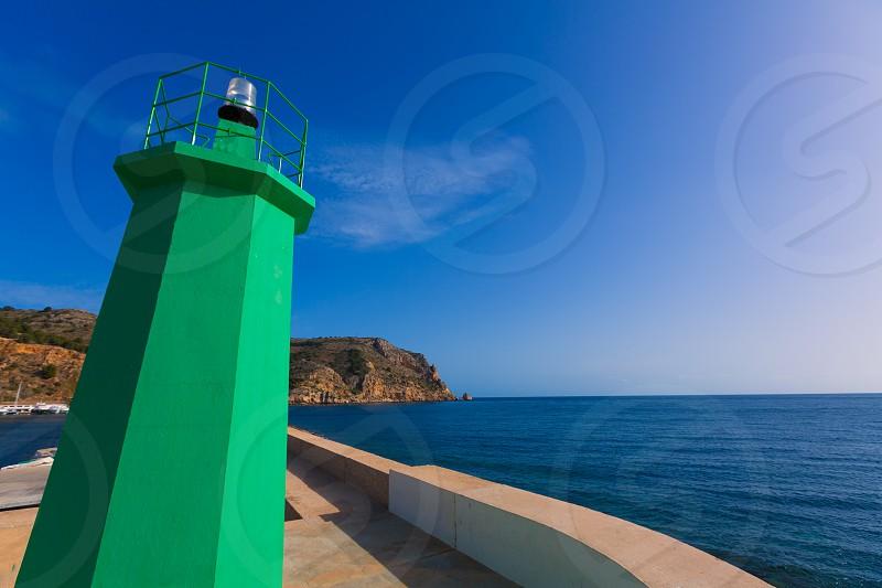 Javea Xabia green lighthouse beacon at Port in Alicante Mediterranean Spain photo