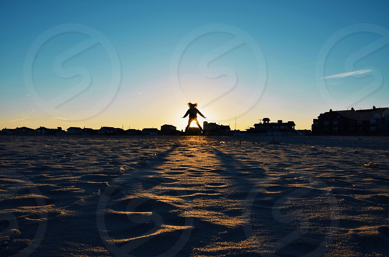 sun rise covered by woman photo
