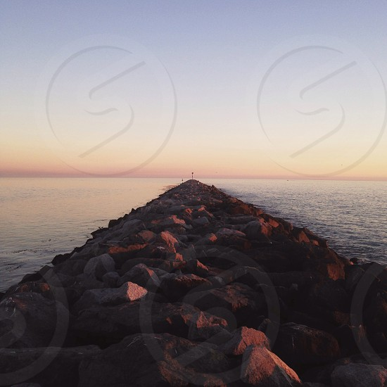 rock pathway and sea photography photo