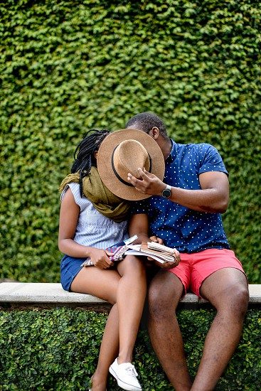 A young black couple explores a new city. They are wrapped up in love for each other. photo