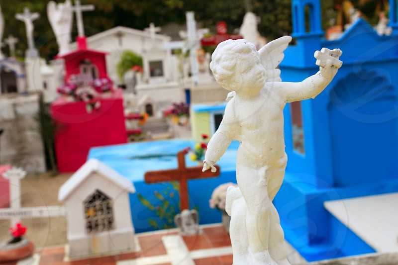 Caribbean children cemetery catholic angel saints figures colorful Mexico photo