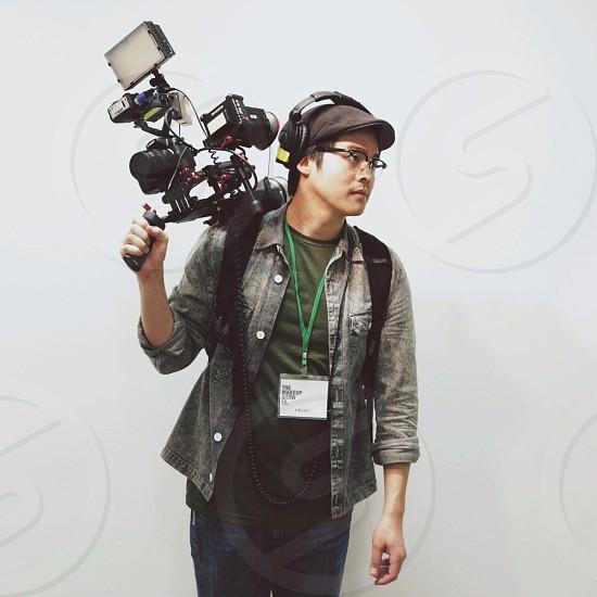 man holding camera photo