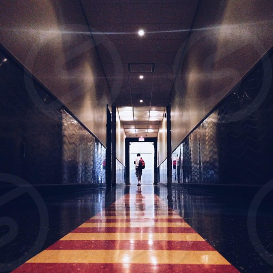 man walking in the hallway photo