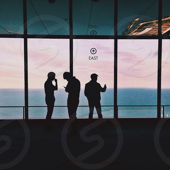 3 men standing photo