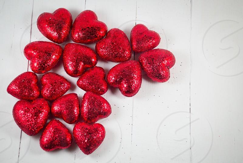 Rad hearts on white wood background. photo