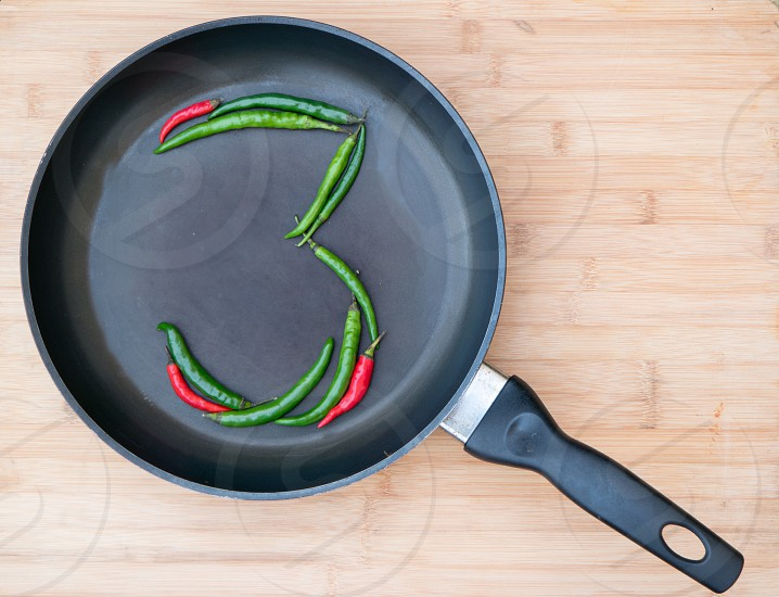 Three 3 number chillies frying pan chopping red green photo