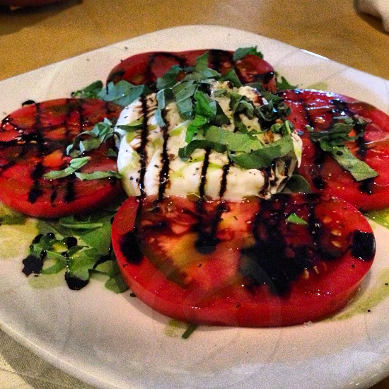 slice red tomato with green vegetable and chocolate syrup photo