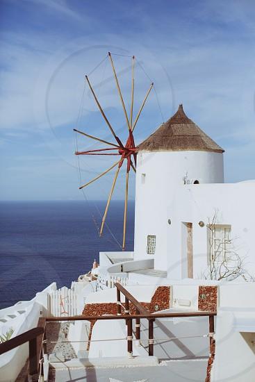 Oia Santorini Greece Europe Island ocean sea mill windmill sky blue white architecture portrait destination wedding travel romance photo