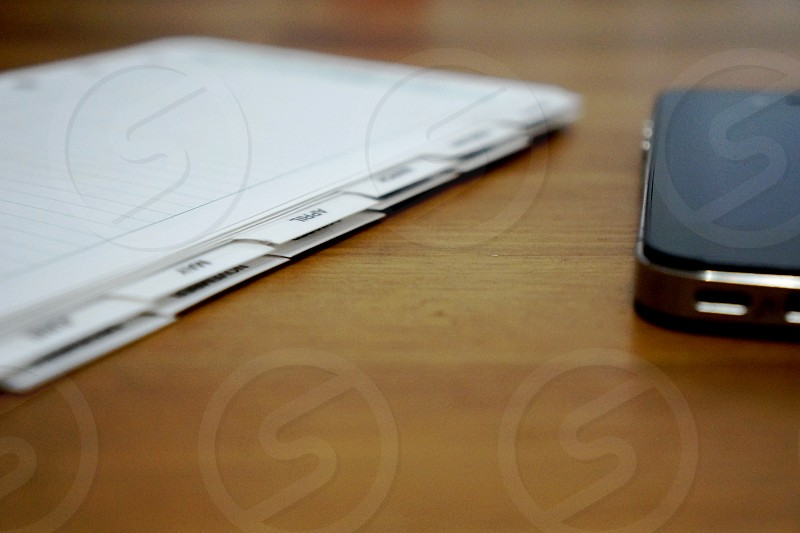 black smatphone near the paper photo