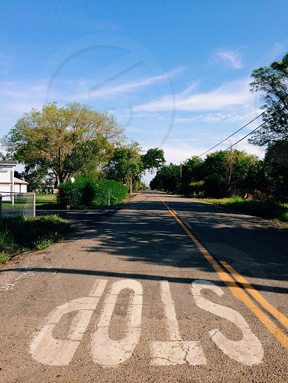 gray concrete road with stop sign print photo