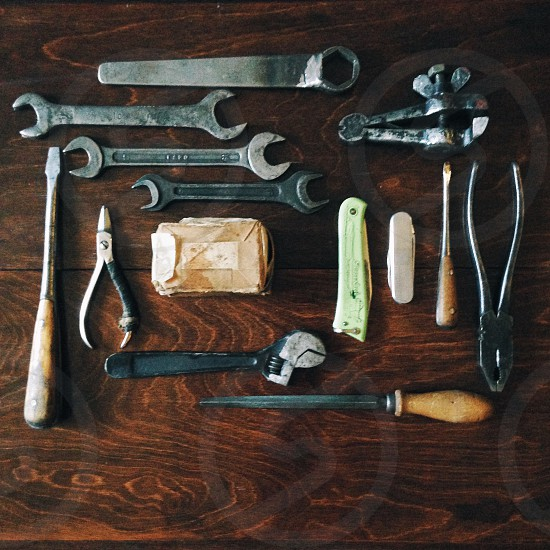 stainless steel wrenches on a brown wooden table photo