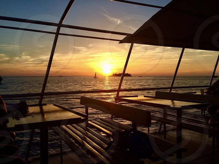 Sunset Portugal island boat sail benches glow sea photo
