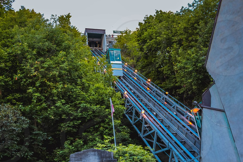 Funicular on the rails between the trees photo