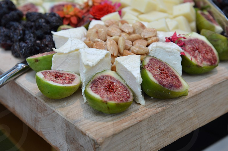 Cheese figs flowers almonds cheese board hits d'oeuvres  photo
