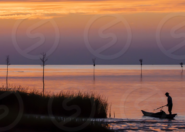 A short fishing trip into a peaceful sunset. photo