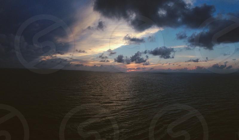 Sunset over the Caribbean while cruising  photo