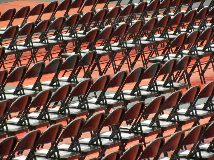 Rows of folding chairs forming a linear pattern. photo