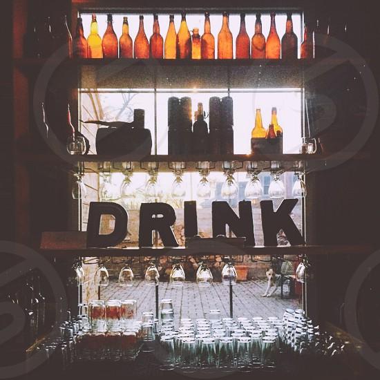 drink freestanding letter near amber glass bottle photo