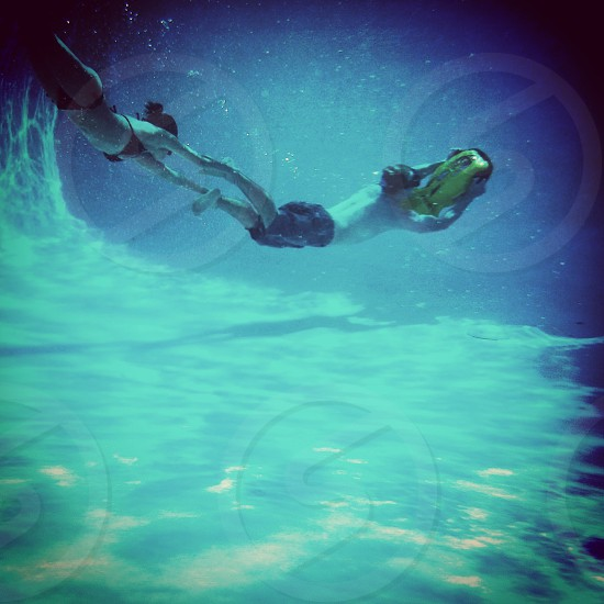 underwater photo of a man and woman photo